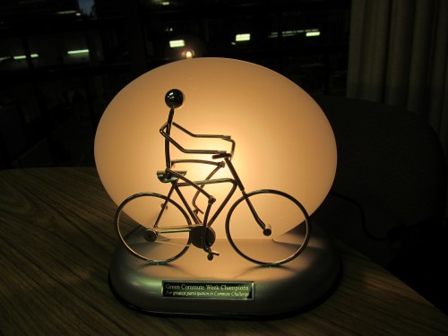 The Green Commute Week Trophy is a moving  bicyclist that is powered by solar energy.