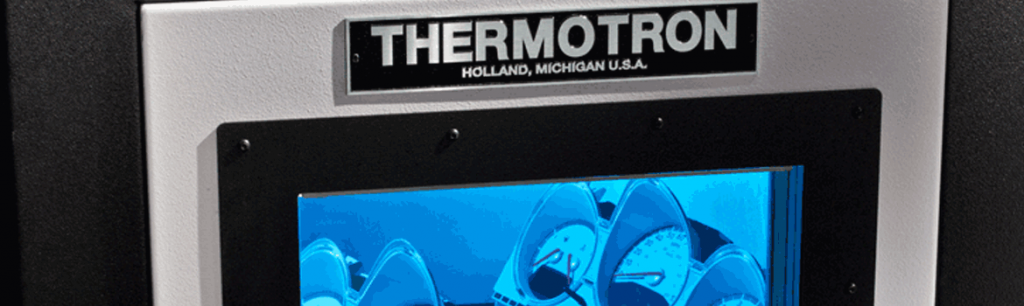 Thermotron Environmental Chamber Door with Automotive Parts Inside - Automotive Testing Expo